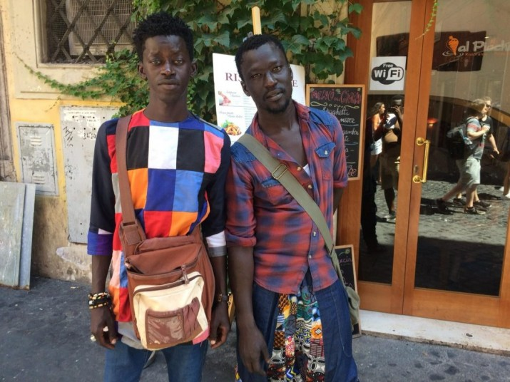 Mbaye Diope (left) and Mornyang (right), both from Senegal, searching for better lives in Rome, Italy [photo by – Eric Kafui Okyerefo]